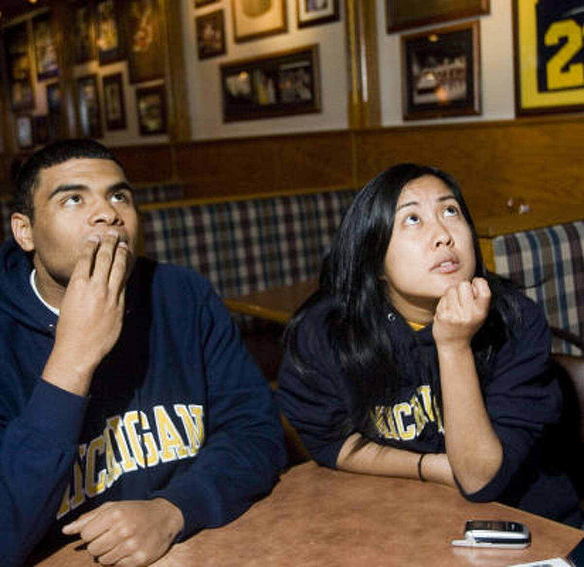 Michigan students James Ellis, left, and Christine Lamorena watch as the BCS pairings are announced.