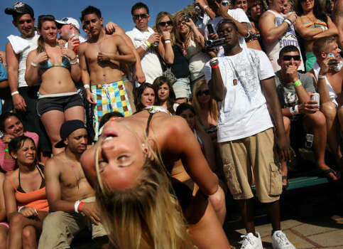 "Students participate in a ""booty shaking"" contest at the MTV Beach Bash party put on by Global Groove at the Bahia Mar Hotel. Photo: Rick Gershon, Getty Images"