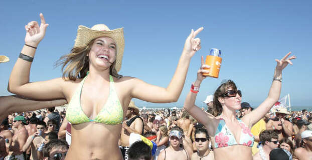 Kayla Moncrief, left, enjoys the music coming from the Full Throttle Energy Spring Break stage. Photo: Billy Smith II, Chronicle