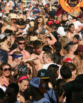 Spring breakers cover the beach as the music blares. Photo: Billy Smith II, Chronicle