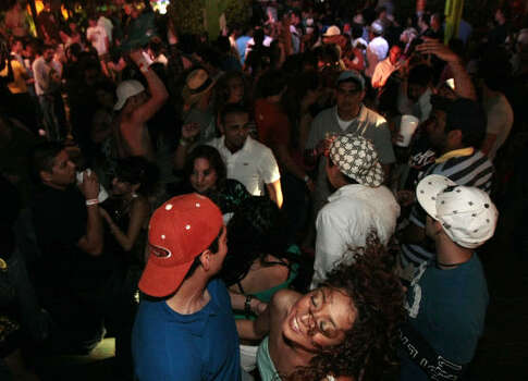 Spring breakers dance at Tequila Frogs while being filmed by the E channel's Wild On series. Photo: Billy Smith II, Chronicle