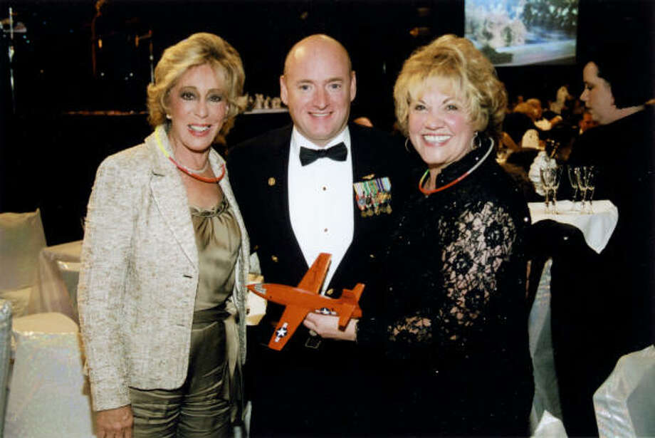 Susan Klein, left, and Edna Meyer-Nelson flank astronaut Scott Kelly at the Houston Children's Charity gala, where Meyer-Nelson was high bidder on a NASA package. Photo: Pete Baatz