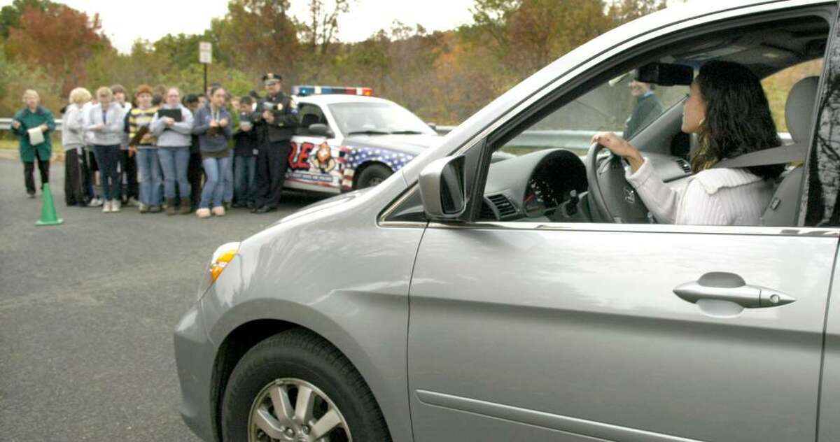 Bethel Middle School teacher Danielle Troetti, drives her car on a course allowing students to calucate distance=rate x time of a moving car. The exercise was done Tuesday, Oct. 13, 2009 in teacher Alison Salerno's pre-Algebra 7th grade class.
