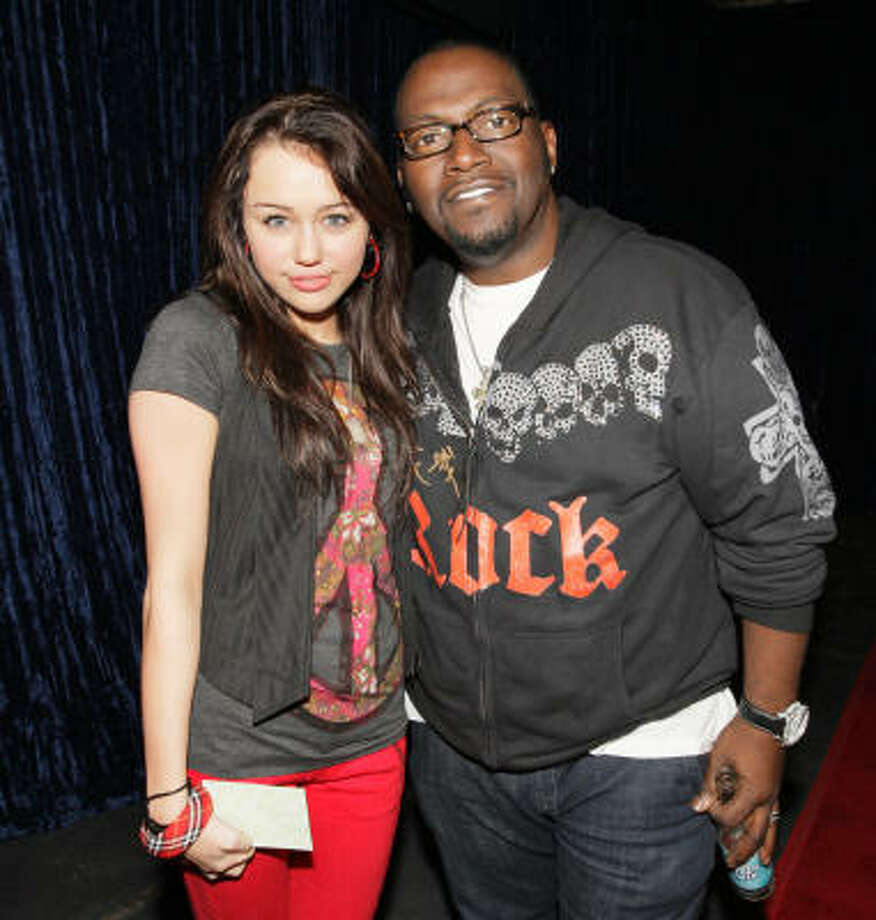 "Where has Miley/Hannah been lately? Here's Miley with Randy Jackson during a February taping of ""Randy Jackson Presents America's Best Dance Crew."" Photo: Chris Polk, AP"