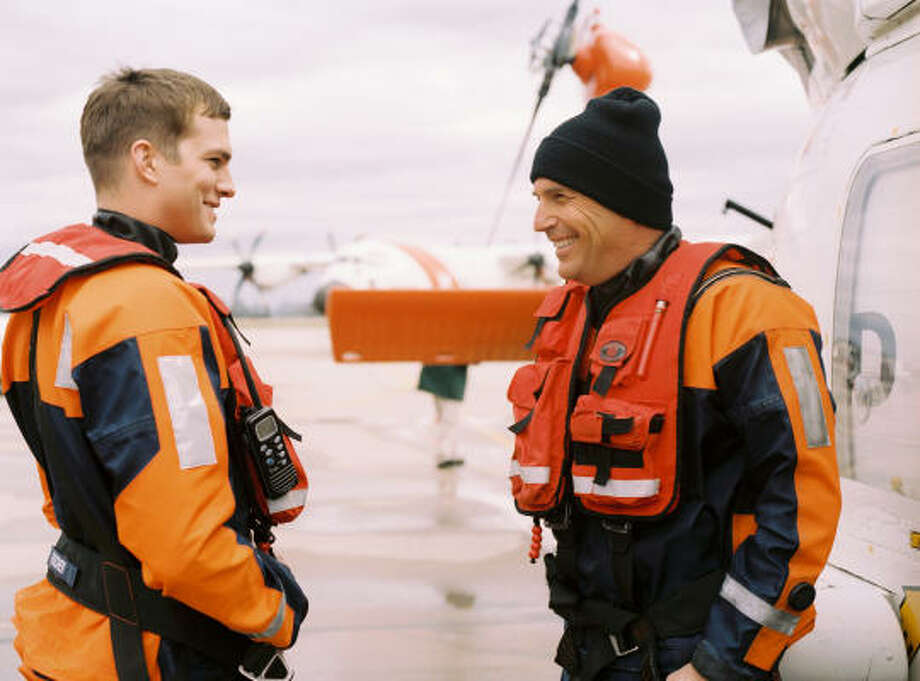 Veteran Ben Randall (Kevin Costner, right) and the younger Jake Fischer (Ashton Kutcher) are dispatched on a rescue mission, in The Guardian. Photo: Lance Steadler, Touchstone