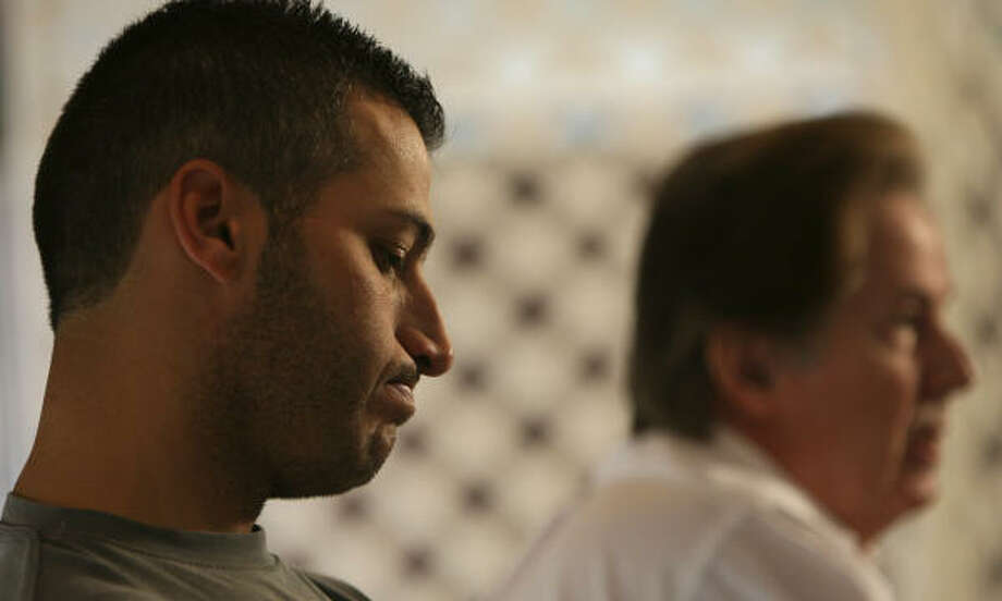 Andy Pettitte listens as his agent, Randy Hendricks, discusses his new deal. Photo: KAREN WARREN, Chronicle