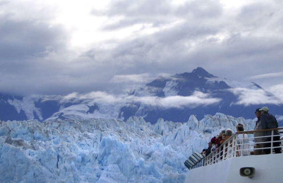 Passengers aboard Royal Caribbean's Radiance of the Seas watch as the ship passes by Alaska's Hubbard Glacier. Photo: Beth Harpaz, Associated Press