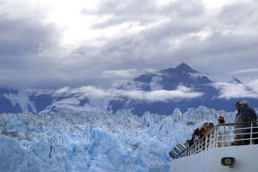 Passengers aboard Royal Caribbean's Radiance of the Seas watch as the ship passes by Alaska's Hubbard Glacier.
