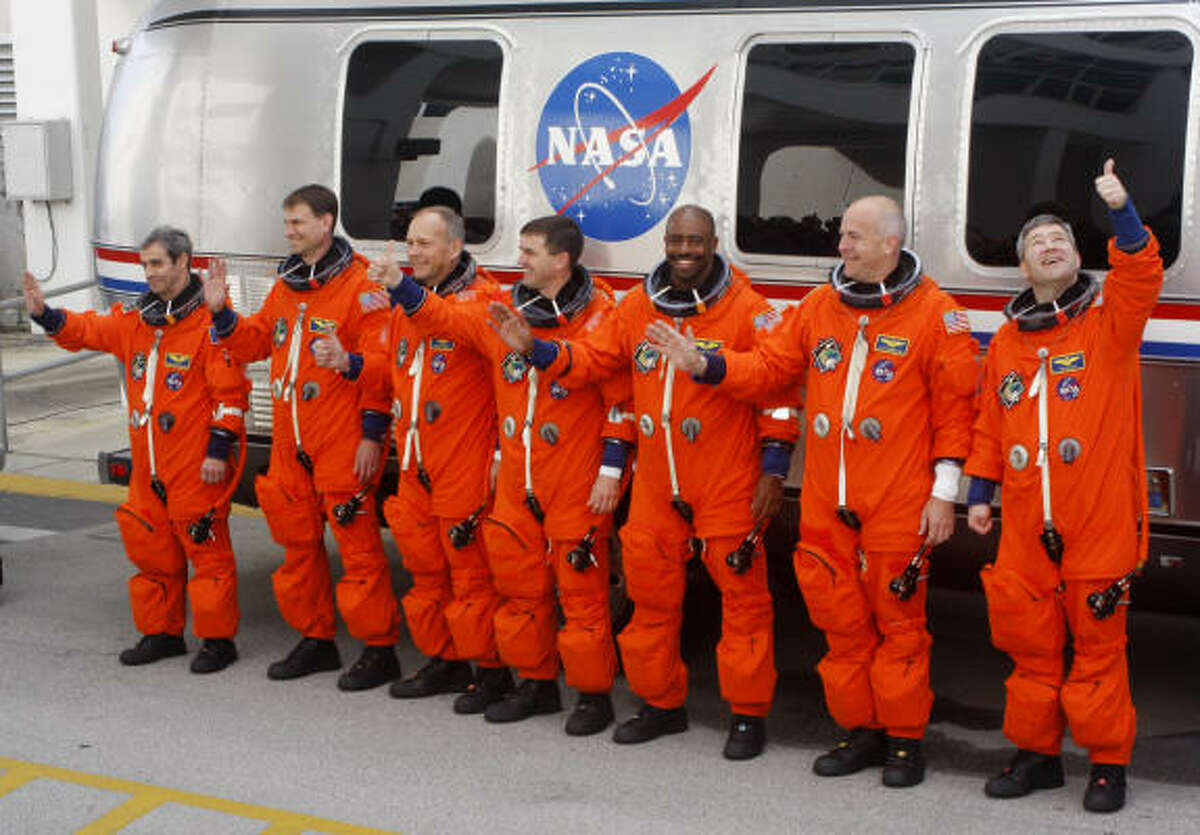 From left, Mission Specialists Leopold Eyharts of France from the European Space Agency, Stanley G. Love of NASA, Hans Schlegel of Germany and the European Space Agency, Rex J. Waldheim of NASA, Leland D. Melvin of NASA, Pilot Alan G. Poindexter and Mission Commander Stephen N. Frick walk out of crew quarters before the launch of the space shuttle Atlantis for mission STS-122 on Thursday at the Kennedy Space Center.