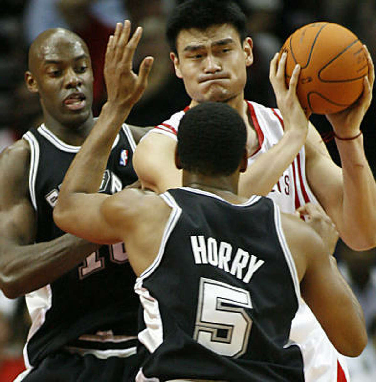 Yao Ming navigates traffic. He finished with 20 points and six rebounds.