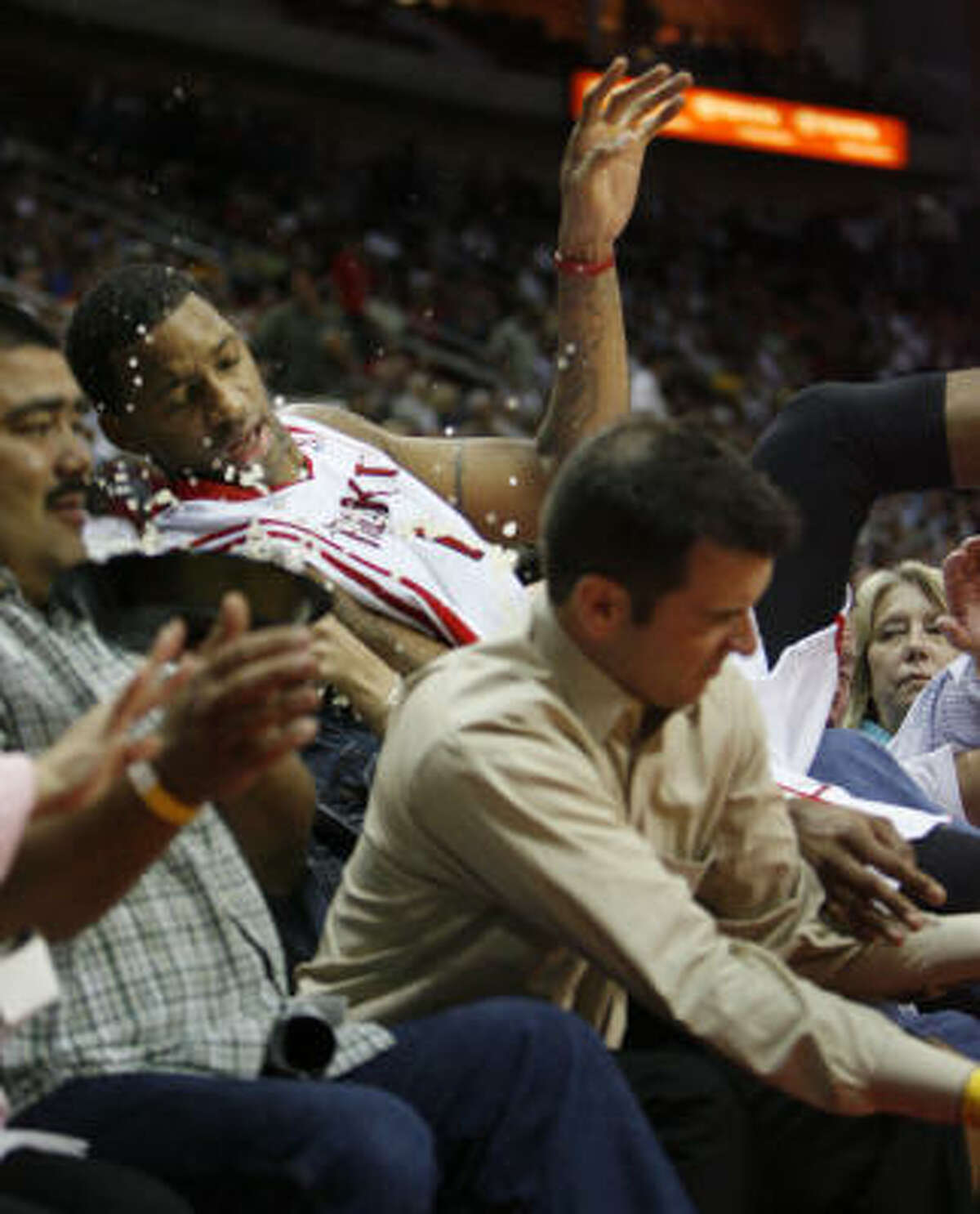 It was this kind of night for the Rockets. Tracy McGrady took a spill into the stands in the second quarter.