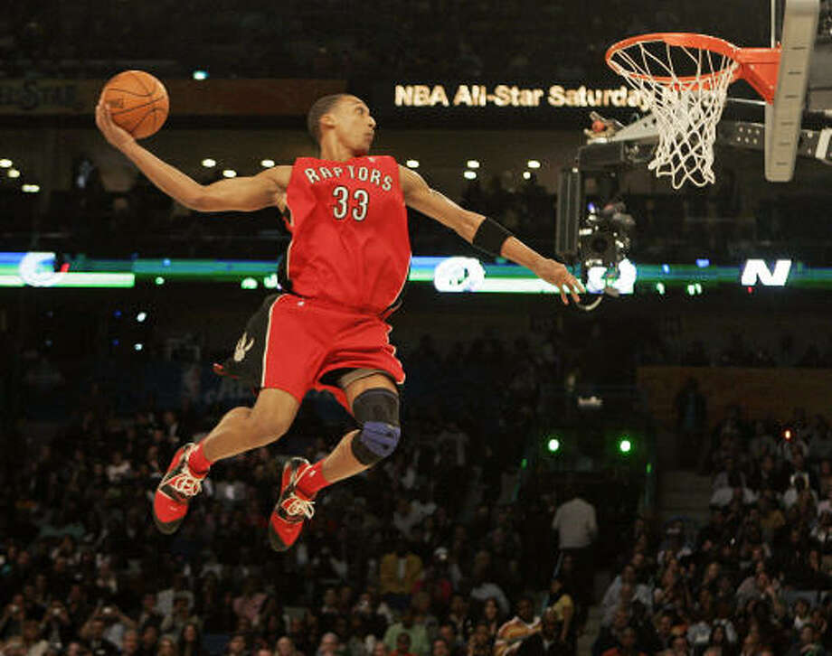 The Raptors' Jamario Moon sails toward the basket during the Slam Dunk Contest at the NBA All Star Weekend  on Saturday. Photo: Eric Gay, AP