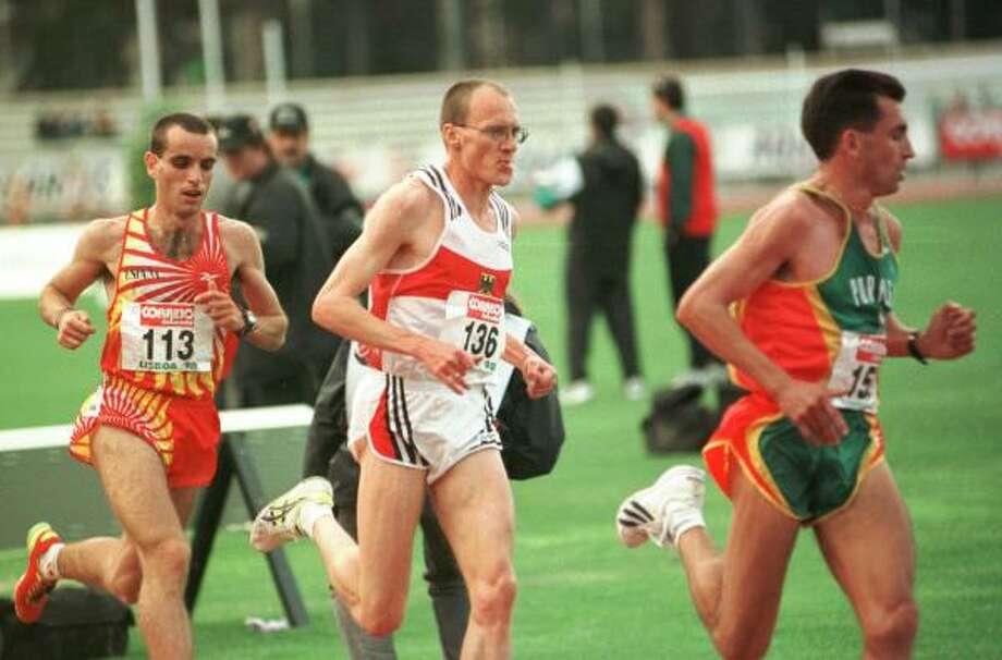 Runner Dieter Baumann (center) blamed toothpaste. Photo: LUISA FERREIRA, AP
