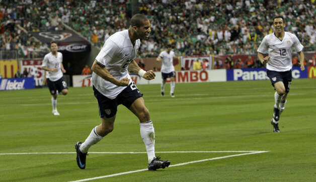 United States defender Oguchi Onyewu celebrates after scoring a goal against Mexico during the first half. Photo: Associated Press