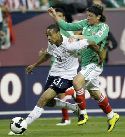 Mexico midfielder Gerardo Torrado, right, tries to steal the ball from United States midfielder Ricardo Clark during the first half. Photo: Associated Press