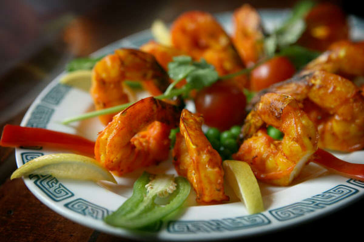 Tandoori-style dishes such as this carefully cooked tandoori shrimp fill the Northern Indian menu at the well-mannered Bombay Brasserie in Rice Village.