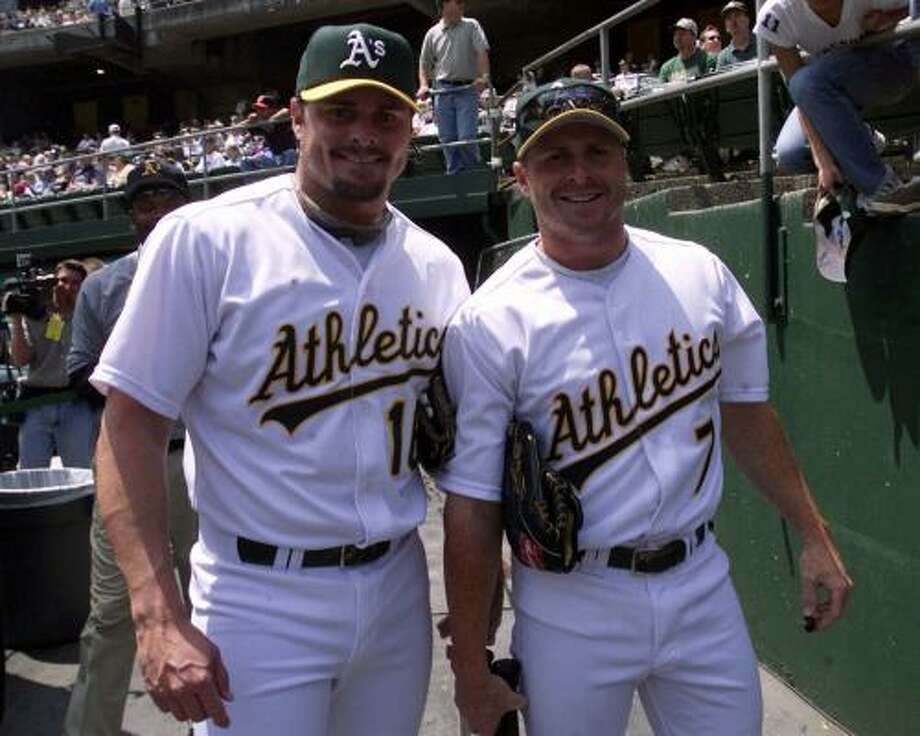 Jason Giambi, left, and brother Jeremy both played for the Oakland 