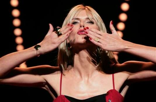 Heidi Klum blows kisses to the audience. Photo: BEBETO MATTHEWS, AP