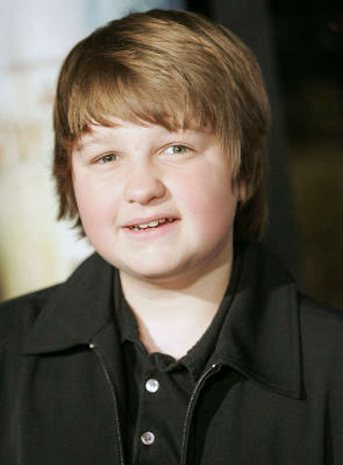 "Angus T. JonesPortrays child Jake Harper on CBS's ""Two and a Half Men"" Per episode salary: $300,000 Source: Time.com  Photo: Dan Steinberg, AP"