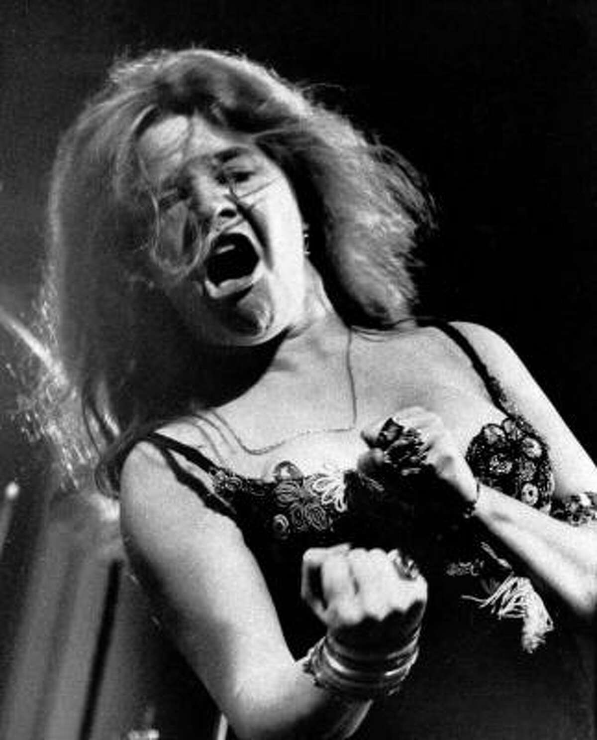 Blues/rock singer Janis Joplin performs at the Newport Folk Festival with her band Big Brother and the Holding Company on July 29, 1968. She died in 1970 at age 27.