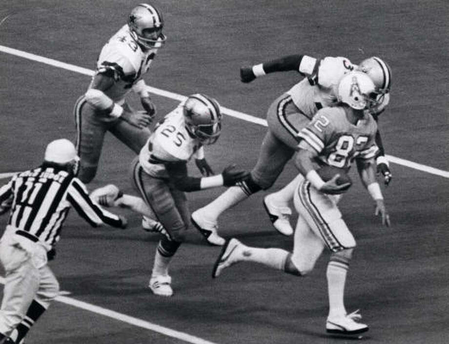 Nov. 2, 1979Oilers 30, Cowboys 24, Texas StadiumBum Phillips' Luv Ya Blue Oilers rallied from a 21-10 deficit to trail 24-23 in the fourth quarter when Dan Pastorini threw a 32-yard touchdown pass to Kenny Burrough to win the game. Pastorini threw two touchdown passes. Earl Campbell ran 33 times for 195 yards and two touchdowns. The defense intercepted Roger Staubach twice and limited running back Tony Dorsett to 54 yards rushing. Both teams finished 11-5. Photo: George Honeycutt, Houston Chronicle