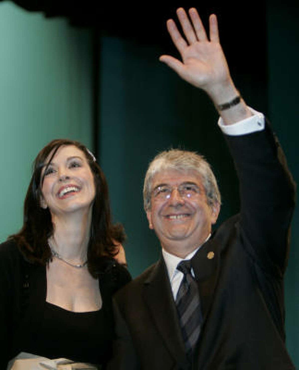 Espada waves to supporters with his daughter, Maria Olga Espada.