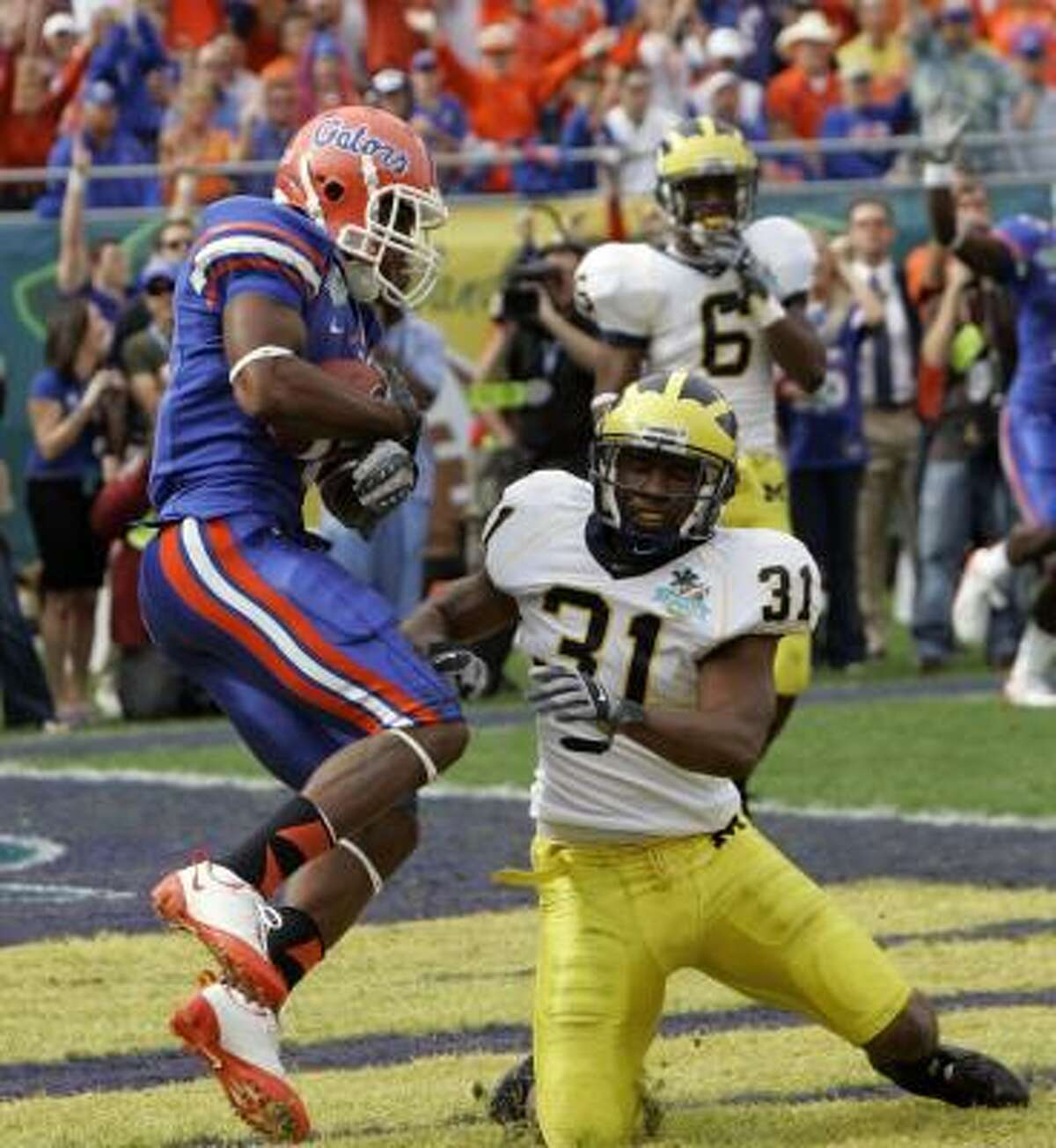 2006: Percy Harvinpictured), WR, Florida (Rivals); Myron Rolle, DB, Florida State (ESPN); Beanie Wells, RB, Ohio State (Scout). Harvin helped the Gators win two national championships in three seasons before heading to the NFL, and Wells was tremendous as well, rushing for nearly 3,400 yards in three years with the Buckeyes. But the most unique path of any top-ranked recruit may belong to Rolle, who was a third-team All-American as a junior. He left the Seminoles not for the NFL draft, but for Oxford University after being named a Rhodes Scholar. Rolle earned a master's degree in medical anthropology, and although he never did play a game in the NFL, he was drafted by the Tennessee Titans in 2010 and was picked up by the Pittsburgh Steelers in 2012.