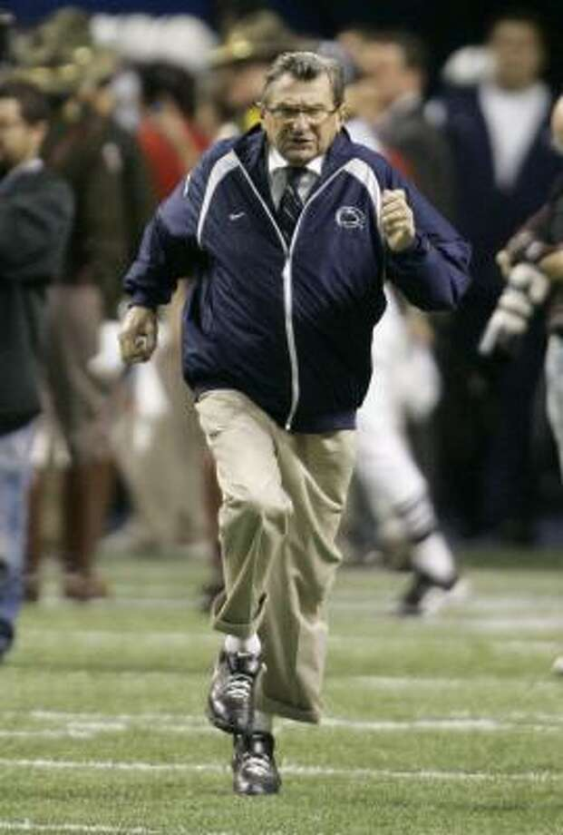 Penn State coach Joe Paterno runs onto the field for his 500th game. Photo: Eric Gay, AP