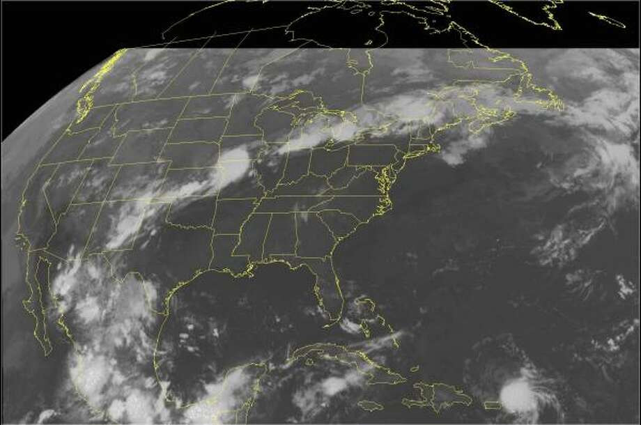 "This NOAA satellite image taken at 1:15 a.m. Thursday shows Tropical Storm Chris to the north and east of Puerto Rico. Chris has some potential to strenghten into a hurricane late this week or over the weekend, and, though the storm was thousands of miles from Houston, earlier this week local television stations led with Chris. ""We're not trying to scare anybody, but it is something on everybody's mind, especially after Katrina and Rita,"" said Mike Iscovitz of Channel 26. Photo: AP"