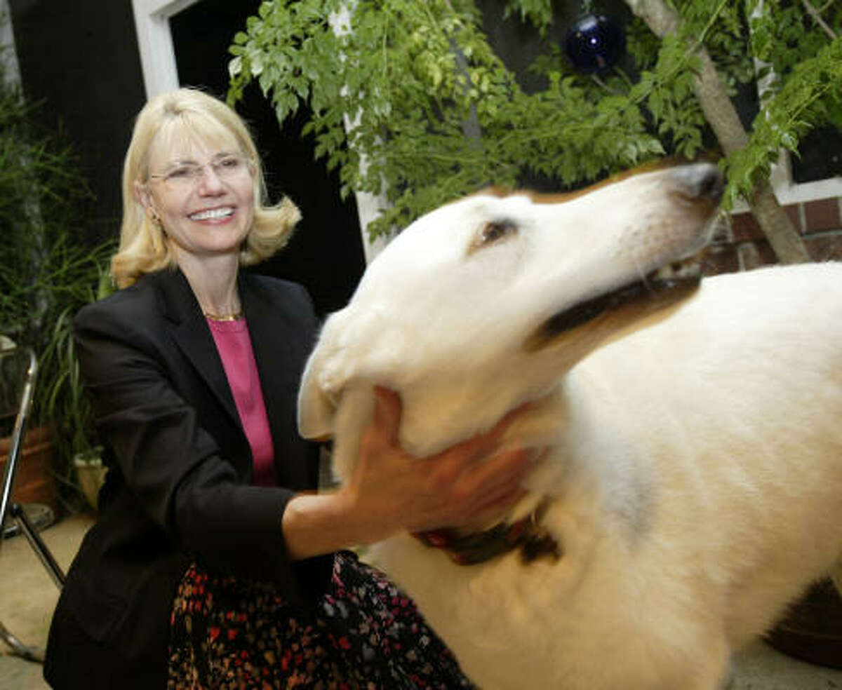 Houston City Councilwoman Shelley Sekula-Gibbs, the Republican write-in candidate to succeed Tom DeLay, says hello to Oscar the dog during an appearance Friday at the Richmond home of Sheryl Kadmon, executive director of the Tourette Syndrome Association of Texas.