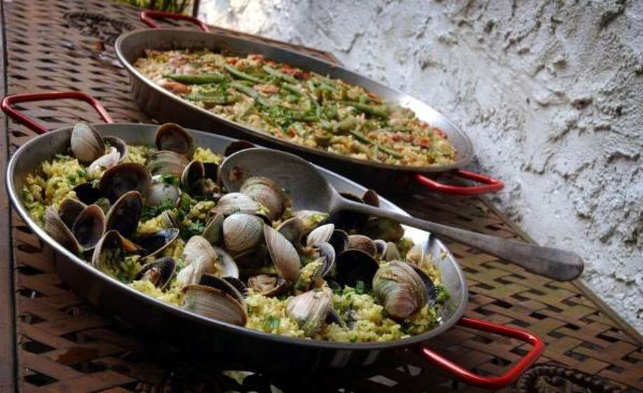 Garlicky Clam Paella is just one version of this classic rice. Photo: THOMAS A. FERRARA, Newsday