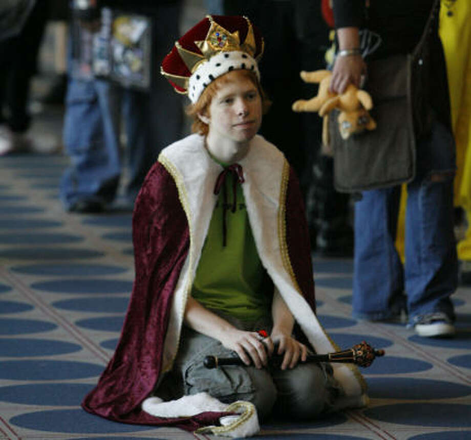 Alex Swift, 18, from Austin, takes a break from standing as he waits in line to enter the third annual Oni-Con at the George R. Brown Convention Center on Friday. Photo: Steve Campbell, Chronicle