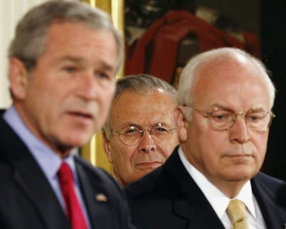 Secretary of Defense Donald Rumsfeld, center, and Vice President Dick Cheney listen to President Bush speak before the signing of the Military Commissions Act of 2006 in the East Room of the White House. Photo: KEVIN LAMARQUE, REUTERS