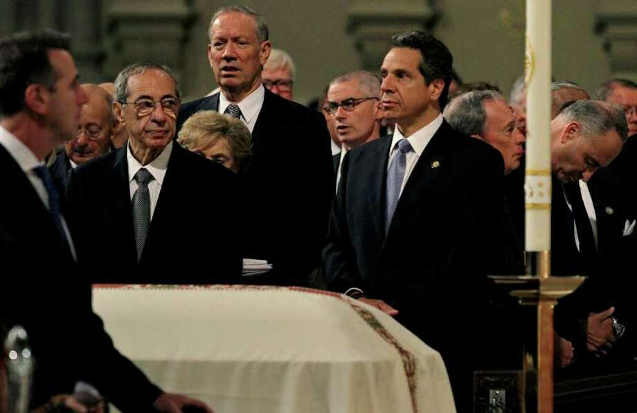 From left, former New York Gov.  Mario Cuomo, George Pataki,  Gov. Andrew Cuomo, New York City Mayor Michael Bloomberg, and Sen. Chuck Schumer stand near the casket of former Gov. Hugh Carey Thursday, Aug. 11, 2011 at St. Patrick's Cathedral in New York.  The Brooklyn-born Carey served two terms as New York governor  from 1975 to 1982 after seven terms as a congressman representing his home borough. Carey died Sunday, Aug. 7, 2011. He was 92.  (AP Photo/Craig Ruttle) Photo: Craig Ruttle