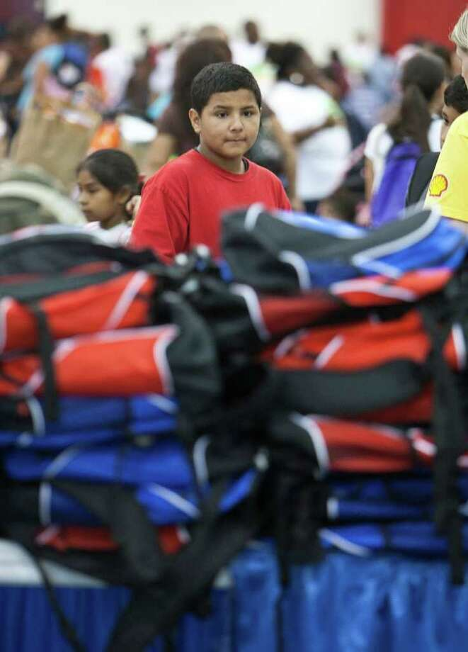 Twelve-year-old Stevie Acosta chooses a backpack during the City Of Houston and Houston ISD Back to School Fest at George R. Brown Saturday, Aug. 6, 2011, in Houston. ( James Nielsen / Chronicle ) Photo: James Nielsen, Staff / © 2011 Houston Chronicle