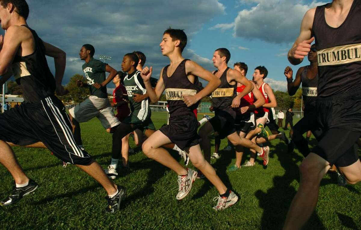 Trumbull's Jake Verone, center, passes by at the start of the boys cross country event at Trumbull High in Trumbull, Conn. on Tuesday Oct. 13, 2009.