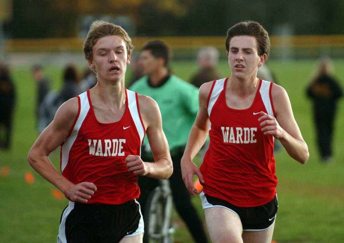 Fairfield Warde's Sam Parton, left, and Michael Robb race to the finish together, during the boys cross country event at Trumbull High in Trumbull, Conn. on Tuesday Oct. 13, 2009. Parton edged out Robb to win.