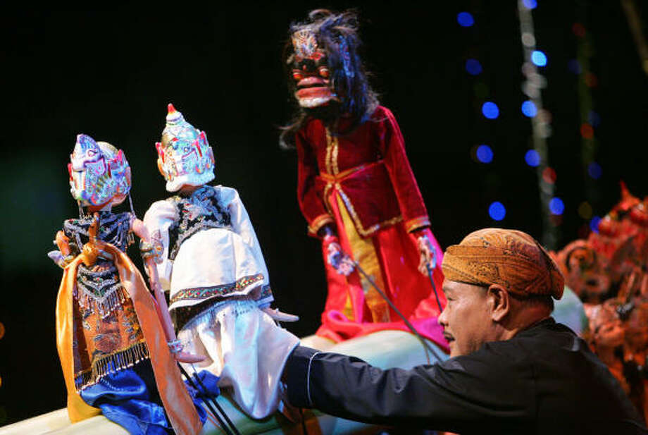 Master puppeteer Asep Sunandar Sunarya performs with hundreds of puppets around Jakarta, Indonesia, warning audience members of the dangers of joining terrorism groups. Photo: ED WRAY, AP