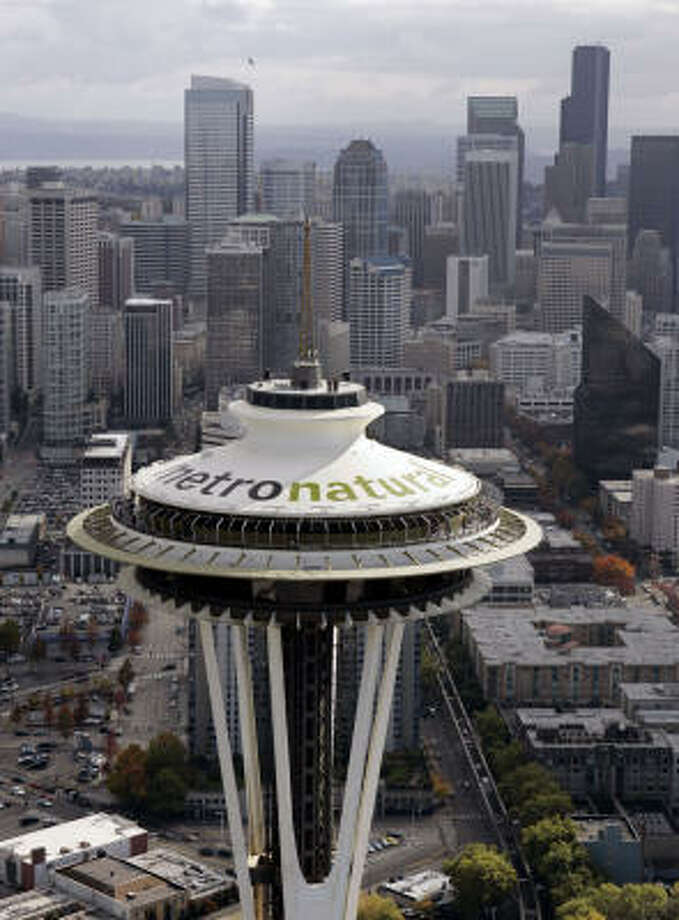 """Seattle's new slogan, """"Metronatural,"""" adorns the landmark Space Needle and highlights the city and nearby nature. Photo: ELAINE THOMPSON, AP"""