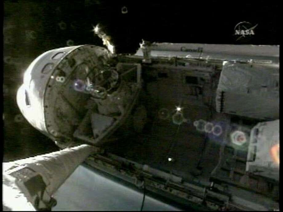 The space shuttle Discovery's docking port can be seen inside the payload bay of the orbiter in this view from a video camera mounted on the spacecraft's robotic arm. Photo: NASA TV, REUTERS