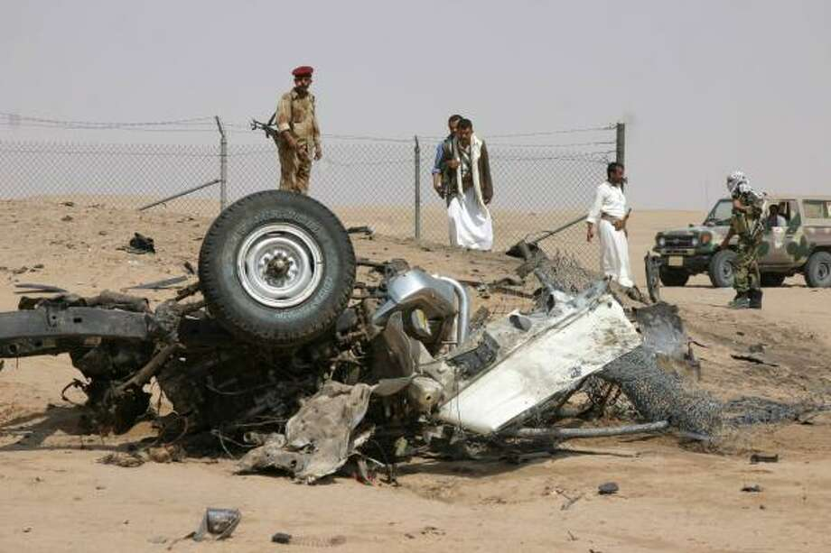 The wreckage of a car bomb destroyed by security guards attracts the curious Friday near the Safir oil refinery in Mareb, Yemen. Photo: Khaled Abdullah, REUTERS