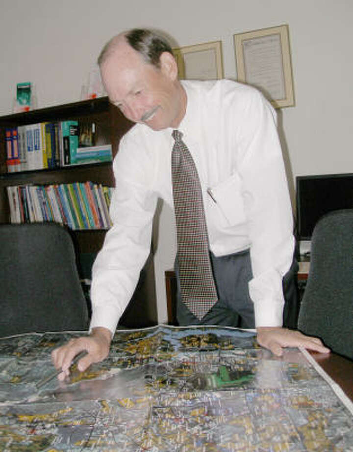 Ray Laughter, vice chancellor for external affairs at North Harris Montgomery Community College District, studies a map recently completed by the North Houston Association that shows current residential, retail and business development. Photo: Harry Williamson, For The Chronicle