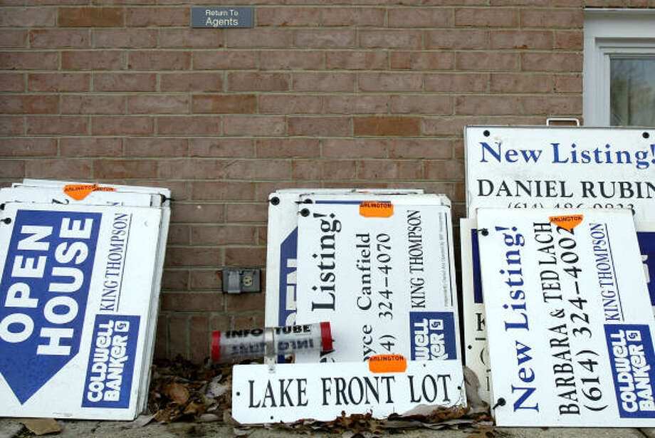 Coldwell Banker signs are stacked against the wall of a branch office in Upper Arlington, Ohio. Realogy Corp. CEO Henry Silverman said the approximately $6.7 billion buyout agreement with Apollo Management may spark other bids for his company. Photo: JAY LAPRETE, BLOOMBERG NEWS