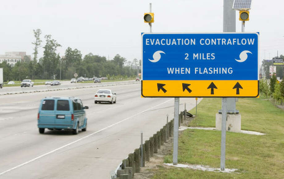 Contraflow traffic signs have been installed on Southeast Texas highways to help ease traffic congestion during the next hurricane evacuation. Photo: BRETT COOMER, CHRONICLE