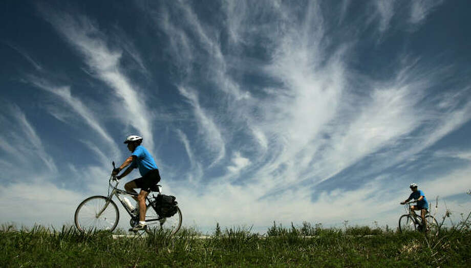 Cyclists travel a wide-open stretch of the Katy Trail near the western end at Clinton, Mo., in June. The 225-mile-long trail could be extended to Kansas City under a proposal by Missouri Gov. Matt Blunt. Photo: CHARLIE RIEDEL, AP