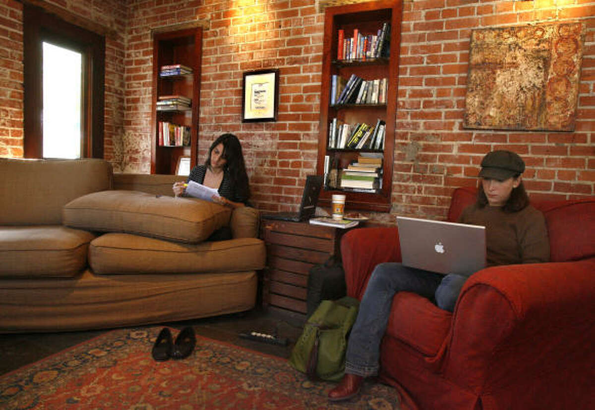 Jennifer Gonzalez-Reinhart, left, and Anastasia Pappas curl up with coffee and their work at Diedrich Coffee on Westheimer before the hangout closed last week. The details of what led to the lease not being renewed are not clear.