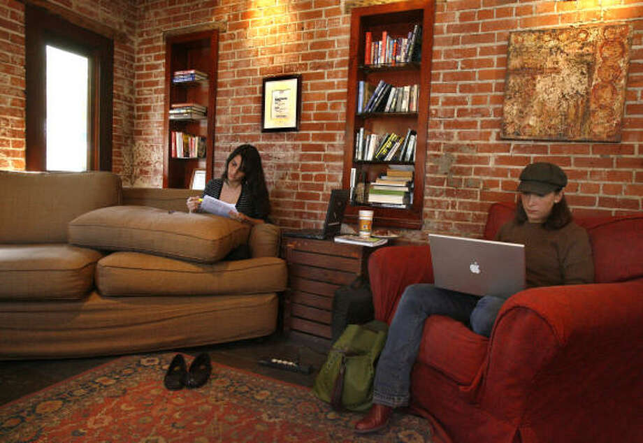 Jennifer Gonzalez-Reinhart, left, and Anastasia Pappas curl up with coffee and their work at Diedrich Coffee on Westheimer before the hangout closed last week. The details of what led to the lease not being renewed are not clear. Photo: Carlos Antonio Rios, Chronicle