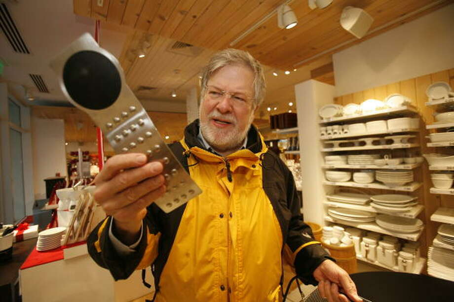 Marshall Wilson checks out a black silicone spoon rest as he does some last-minute shopping Sunday at Crate & Barrel in Highland Village. Wilson says he looks for off-beat gifts to continue a family tradition. Photo: Steve Campbell, Chronicle