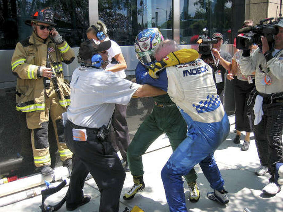 Champ Car driver Paul Tracy has been involved in altercations with other drivers, including Alex Tagliani, center left, after a collision knocked them out of the San Jose Grand Prix on July 30. Photo: AP