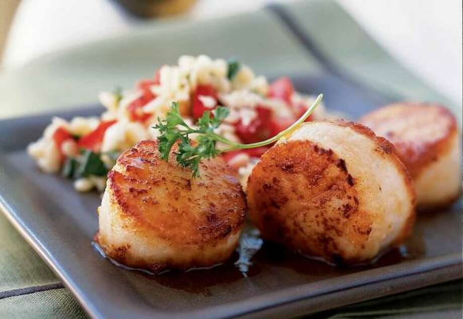 It takes two to three minutes of searing per side to get crispy yet tender scallops. Photo: BECKY LUIGART-STAYNER, COOKING LIGHT